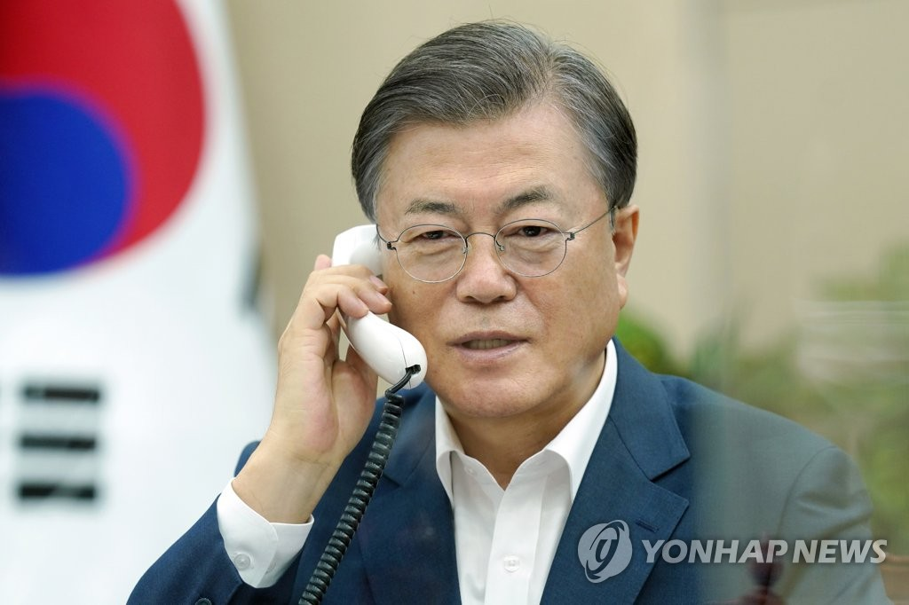 President Moon Jae-in speaks with Canada's Prime Minister Justin Trudeau over the phone at Cheong Wa Dae in Seoul on Oct. 27 2020 in this