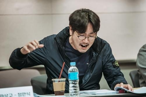 This photo, provided by BA Entertainment, shows Cho Jin-woong during a rehearsal reading of the movie script. (Yonhap)