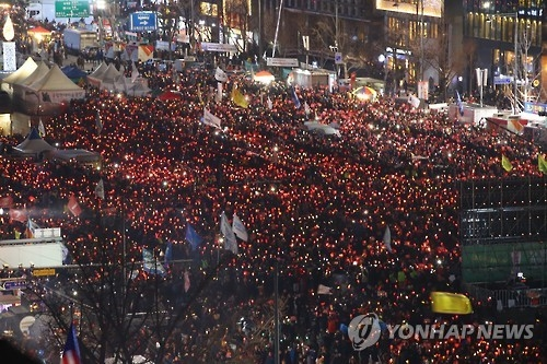 Hundreds of thousands of protesters hold their 17th weekly candlelight vigil in central Seoul, calling for the impeachment of President Park Geun-hye. The rally's organizer put the turnout at an estimated 800,000. (Yonhap)