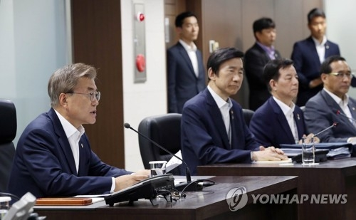 South Korean President Moon Jae-in (L) speaks at the National Security Council meeting held in Seoul on June 8, 2017, hours after North Korea launched what were believed surface-to-ship cruise missiles from its east coast. (Photo courtesy of Cheong Wa Dae)