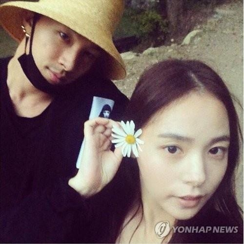This undated file photo shows Taeyang (L) and Min Hyo-rin together as a couple. (Yonhap)