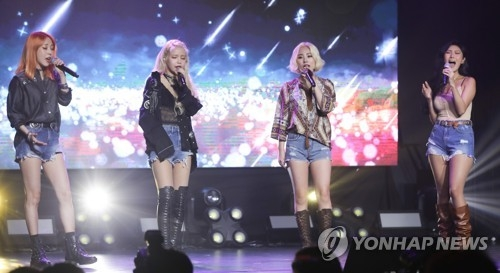 "Members of K-pop group Mamamoo sing on stage during a media showcase for their new album, ""Yellow Flower,"" on March 7, 2018, at Yes24 MUV Hall in western Seoul. (Yonhap)"
