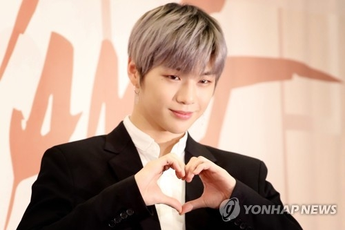 Kang Daniel, singer of project boy band Wanna One, poses for photos during a press conference for the group's new EP on March 19, 2018, at Stanford Hotel in western Seoul. (Yonhap)