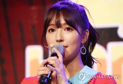 In this file photo, Mikami Yua, lead singer of Honey Popcorn, speaks to reporters during a showcase for the group's debut album in Seoul on March 21, 2018. (Yonhap)