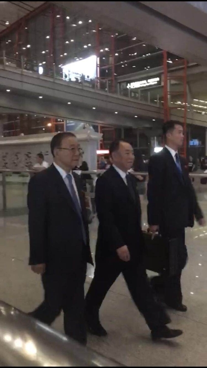 Kim Yong-chol (center), vice chairman of the central committee of North Korea's ruling Workers' Party, walks after arriving at Beijing's Capital International Airport on June 3. (Yonhap)