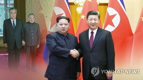 This image provided by Yonhap News TV shows Chinese President Xi Jinping (R) and North Korean leader Kim Jong-un. (Yonhap)