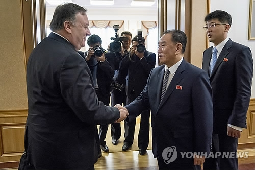 This AP photo shows U.S. Secretary of State Mike Pompeo (L) shaking hands with Kim Yong-chol, a top North Korean communist party official, at the Baekhwawon Guesthouse in Pyongyang on July 7, 2018. (Yonhap)