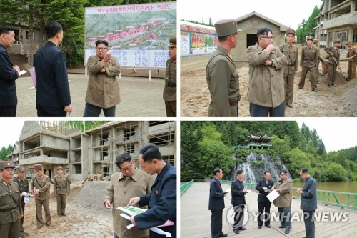 (2nd LD) N.K. leader Kim inspects construction sites, farm