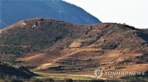 This photo, provided by Green Korea on May 26, 2018, shows a bare mountain in North Korea's border city of Kaesong. (Yonhap)