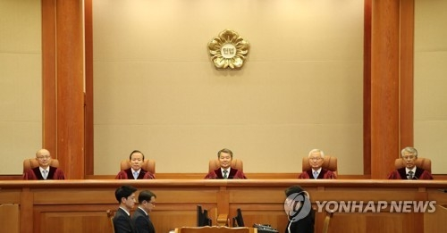 The photo shows Constitutional Court justices on June 28, 2018, ahead of a ruling on conscientious objectors' refusal to fulfill their mandatory military service. (Yonhap)
