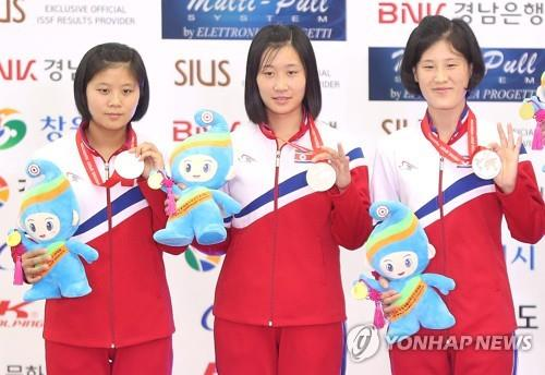 In this file photo from Sept. 9, 2018, North Korean shooters Paek Ok-sim, Ri Ji-ye and Han Chol-sim (from L) hold up their silver medals from the women's 10-meter running target team event at the International Shooting Sport Federation (ISSF) World Championship at Changwon International Shooting Centre in Changwon, 400 kilometers southeast of Seoul. (Yonhap)