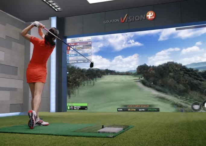 "This photo provided by Golfzon shows a player teeing off as part of a virtual reality (VR) game, commonly referred to as ""screen golf."" (Yonhap)"
