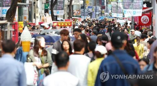 This file photo, taken Sept. 26, 2018, shows Seoul's Myeongdong shopping district crowded with visitors. (Yonhap)