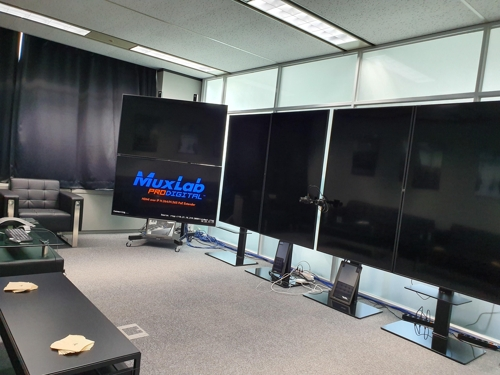 This photo shows a multi-screen meeting room at the Seoul studio of Scanline VFX. (Yonhap)