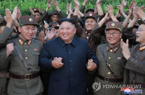 "North Korean leader Kim Jong-un (C) celebrates with North Korean soldiers after watching the firing of ""new-type tactical guided missiles"" on Aug. 6, 2019, in this photo released by the North's official Korean Central News Agency (KCNA) on Aug. 7. Kim said this week's missile launches were an ""adequate warning"" against the joint military exercise between South Korea and the United States that kicked off earlier this week, the KCNA said. (For Use Only in the Republic of Korea. No Redistribution) (Yonhap)"