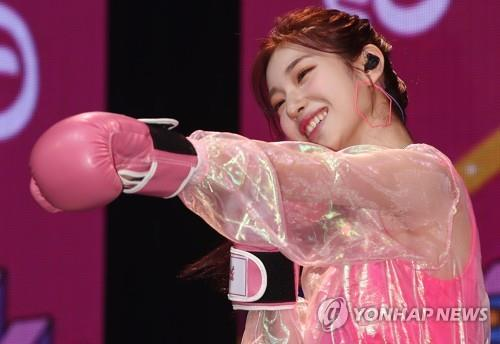 "Suyun, a member of K-pop girl band Rocket Punch, punches the air during a media showcase for the group's debut album, ""Pink Punch,"" on Aug. 7, 2019. (Yonhap)"