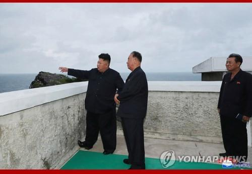 This photo released on Aug. 11, 2019, by the North's Korean Central News Agency captures its leader Kim Jong-un (L) watching the test-firing of missiles that took place the previous day. (For Use Only in the Republic of Korea. No Redistribution) (Yonhap)
