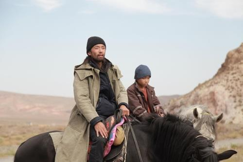 "This image, provided by the Busan International Film Festival (BIFF), shows a scene from ""The Horse Thieves. Roads of Time."" (PHOTO NOT FOR SALE) (Yonhap)"