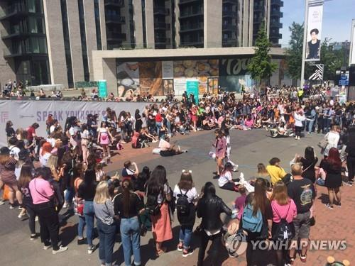 Fans stage an outdoor dance performance BTS choreography ahead of the band's concert at Wembley Stadium in London on June 1, 2019. (Yonhap)
