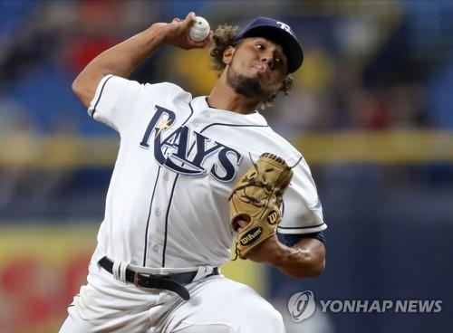 In this Getty Images file photo from Aug. 31, 2019, Ricardo Pinto, then with the Tampa Bay Rays, pitches against the Cleveland Indians in the top of the eighth inning of a Major League Baseball regular season game at Tropicana Field in St. Petersburg, Florida. (Yonhap)