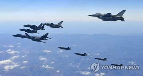 A B-1B Lancer strategic bomber, two F-35A and two F-35B stealth jets of the U.S., and two F-16K and two F-15K fighters of South Korea fly in formation over the Korean Peninsula in a joint South Korea-U.S. air force drill, Vigilant Ace, on Dec. 6, 2017, in this photo provided by the Air Force. The exercise against North Korean provocations was the biggest in its history, but the annual drill was suspended the following year. (Yonhap)