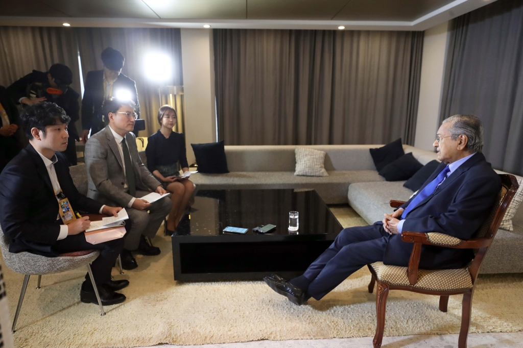 Malaysian Prime Minister Mahathir Mohamad is interviewed by Yonhap News Agency at his hotel in Busan on Nov. 25, 2019. (Yonhap)