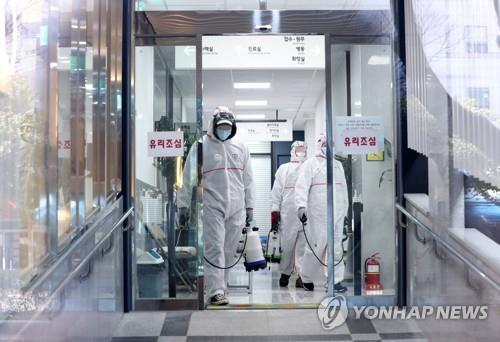 Health authorities disinfect a hospital in Busan, 450 kilometers southeast of Seoul, on Feb. 24, 2020. (Yonhap)
