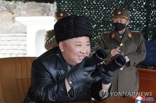 North Korean leader Kim Jong-un (front) watches a firepower strike drill by the North Korean army's long-range artillery sub-units on March 2, 2020, in this photo released by the North's official Korean Central News Agency the next day. The report came one day after South Korea said the North fired what appeared to be two ballistic missiles. (For Use Only in the Republic of Korea. No Redistribution) (Yonhap)
