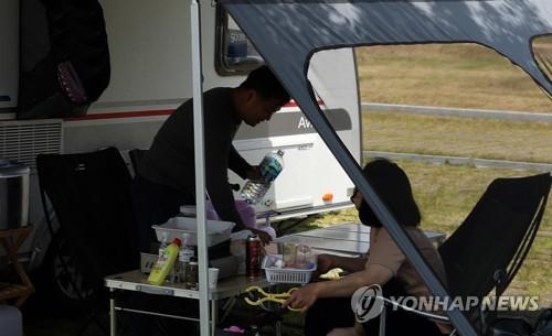 Campers relax at a car camping site in Haman, South Gyeongsang Province, on May 12, 2020. (Yonhap)