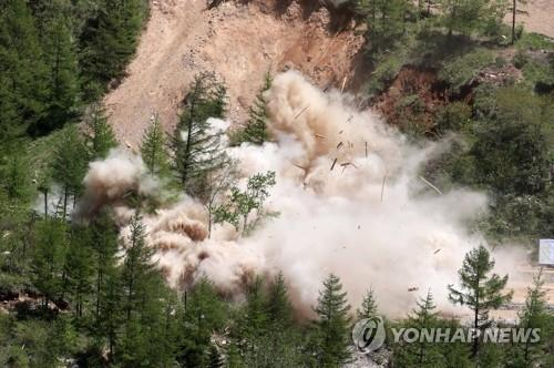 This press pool photo shows a tunnel of North Korea's only known nuclear test site, Punggye-ri, being blown up on May 24, 2018. The North's Korean Central News Agency said tunnels, all kinds of equipment, the control center and a research institute at the site were dismantled. (Yonhap)