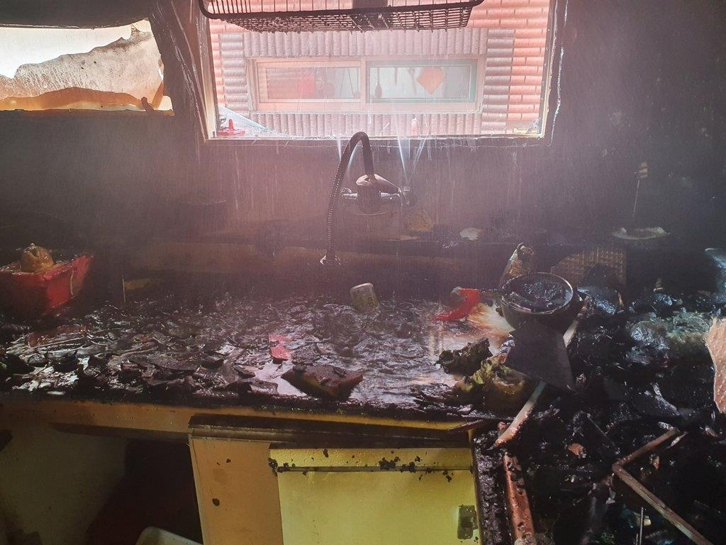 This photo provided by the Incheon Nambu Fire Station shows the burned down home of the two young boys in Incheon. (PHOTO NOT FOR SALE) (Yonhap)