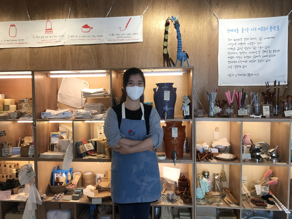 Yang Rae-gyo, a co-owner of Almang Market in western Seoul, stands in front of the store's selection of eco-friendly products on Sept. 22, 2020. (Yonhap)