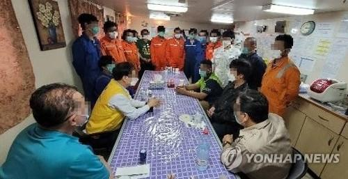 This image provided by the Ministry of Foreign Affairs shows officials of the Korean Embassy in Iran having a meeting with sailors inside the MT Hankuk Chemi oil tanker on Feb. 4, 2021. (PHOTO NOT FOR SALE) (Yonhap)