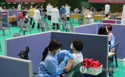 Citizens receive COVID-19 vaccines at a vaccination center in Gwangju, 330 kilometers south of Seoul, on April 12, 2021, as the rollout of the controversial AstraZeneca vaccines resumed. (Yonhap)
