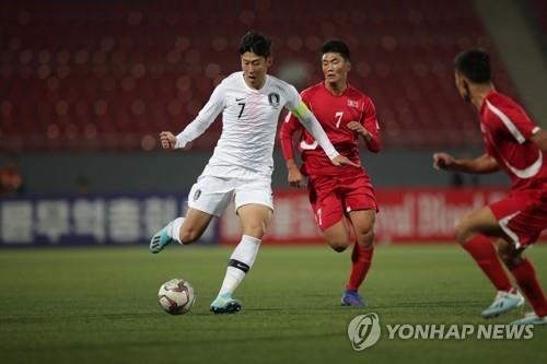 In this photo provided by the Korea Football Association on Oct. 15, 2019, Son Heung-min of South Korea (L) battles Han Kwaong-song of North Korea (C) for the ball during the teams' World Cup qualifying match at Kim Il-sung Stadium in Pyongyang. (PHOTO NOT FOR SALE) (Yonhap)