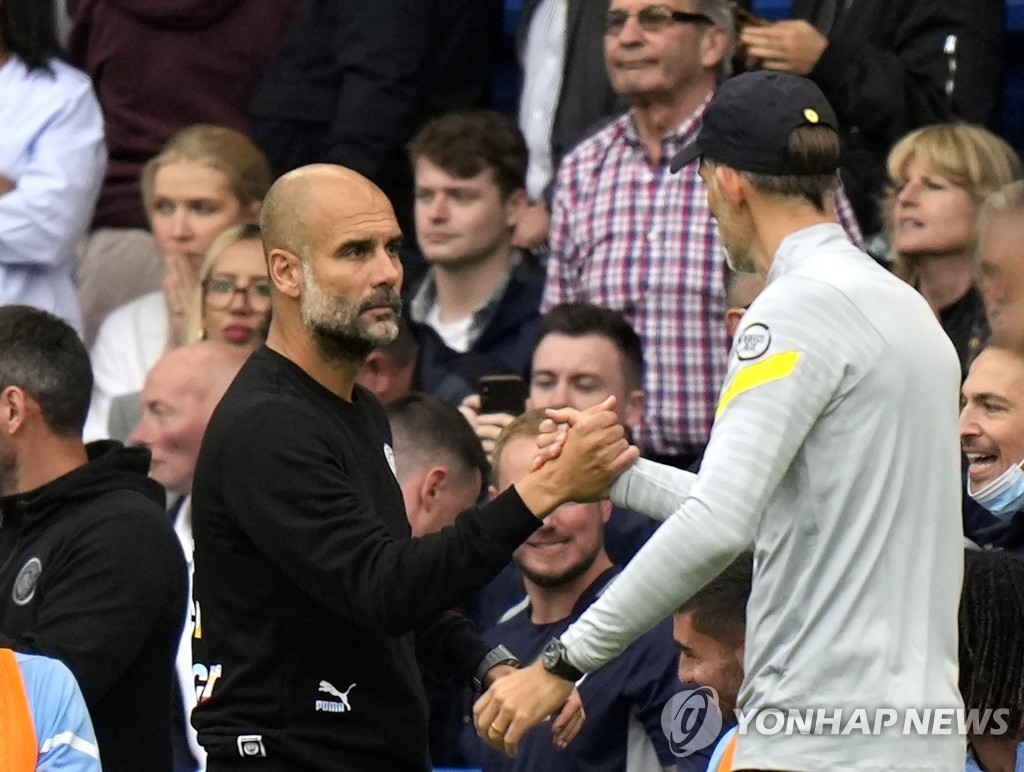 Guardiola and Tuchel greet each other after the match