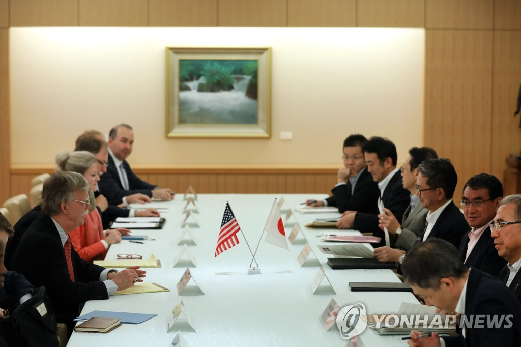 This AFP photo shows U.S. National Security Advisor John Bolton (front L) meeting with Japan's Foreign Minister Taro Kono (2nd from R), joined by their aides, in Tokyo on July 22, 2019. (Yonhap)