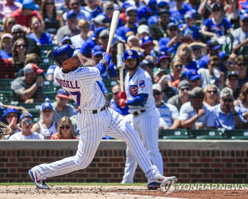 In this EPA file photo from July 17, 2019, Addison Russell of the Chicago Cubs hits a home run in the bottom of the second inning of a Major League Baseball regular season game against the Cincinnati Reds at Wrigley Field in Chicago. (Yonhap)