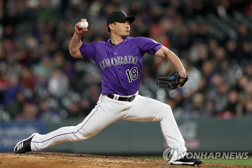 In this Getty Images file photo from April 22, 2019, Oh Seung-hwan of the Colorado Rockies throws a pitch against the Washington Nationals in the top of the seventh inning of a Major League Baseball regular season game at Coors Field in Denver. (Yonhap)