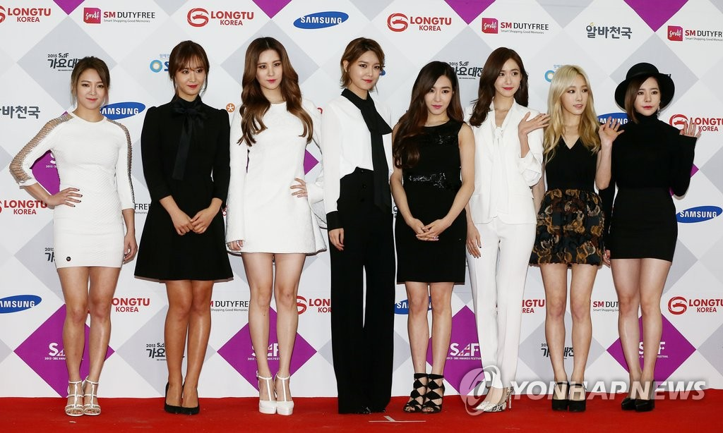 This file photo taken Dec. 27, 2015, shows South Korean girl group Girls' Generation posing for a photo during a music festival of K-pop stars, organized by the broadcaster SBS, at the Convention and Exhibition Center in Seoul. (Yonhap)