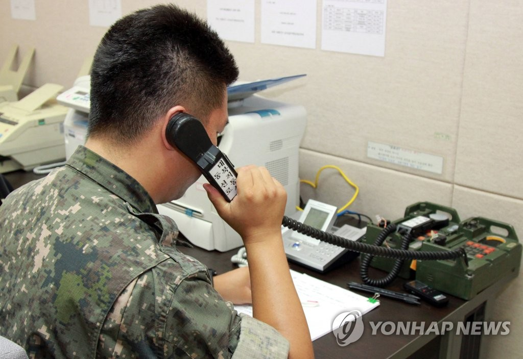 This undated file photo shows a South Korean officer checking a western military hotline with North Korea. During high-level talks on Jan. 9, 2018, North Korea told the South that it has recently restored the communication channel severed for nearly two years, according to Seoul officials. (Yonhap)