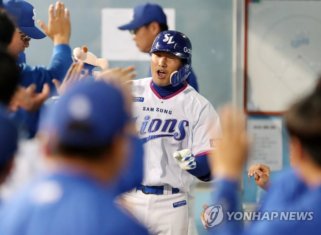 In this file photo from April 20, 2018, Kim Sang-su of the Samsung Lions is greeted by his teammates after hitting a solo home run against the KT Wiz in the bottom of the sixth inning of a Korea Baseball Organization regular season game at Daegu Samsung Lions Park in Daegu, 300 kilometers southeast of Seoul. (Yonhap)