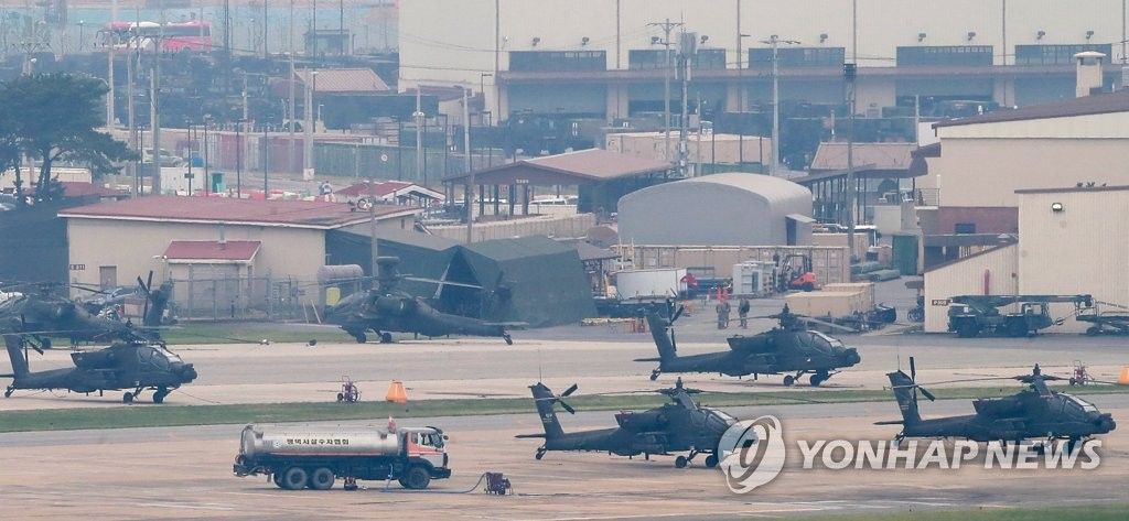 The file photo, taken June 19, 2018, shows a number of military choppers sitting on the ground at the U.S. military base Camp Humphreys in Pyeongtaek, some 70 kilometers south of Seoul, after South Korea and the United States said they decided to suspend their annual joint military exercises in August to foster a mood for dialogue with North Korea. (Yonhap)
