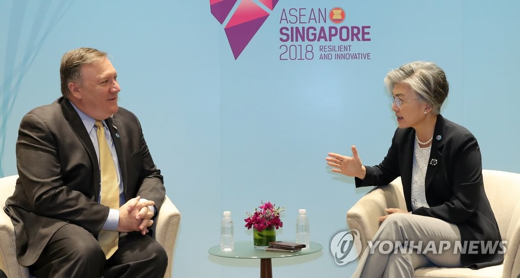 This photo, taken on Aug. 4, 2019, shows South Korean Foreign Minister Kang Kyung-wha (R) talking with U.S. Secretary of State Mike Pompeo on the sidelines of a multilateral forum in Singapore. (Yonhap)