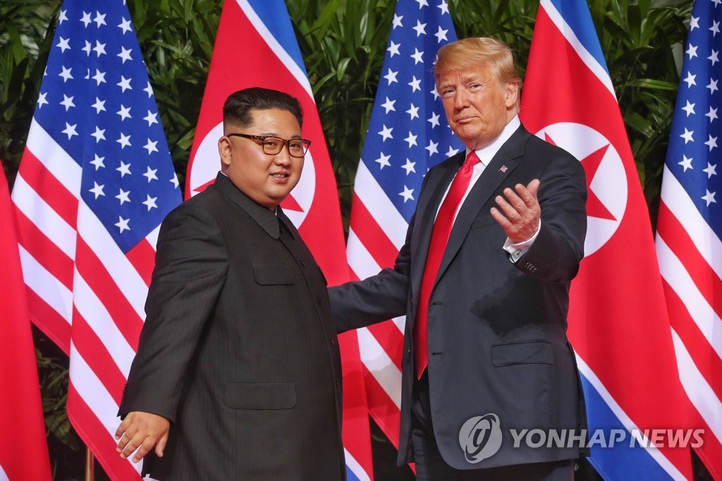 This file photo shows North Korean leader Kim Jong-un (L) and U.S. President Donald Trump at their first summit in Singapore on June 12, 2018. (Yonhap)