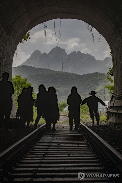 Tourists visit closed tunnel