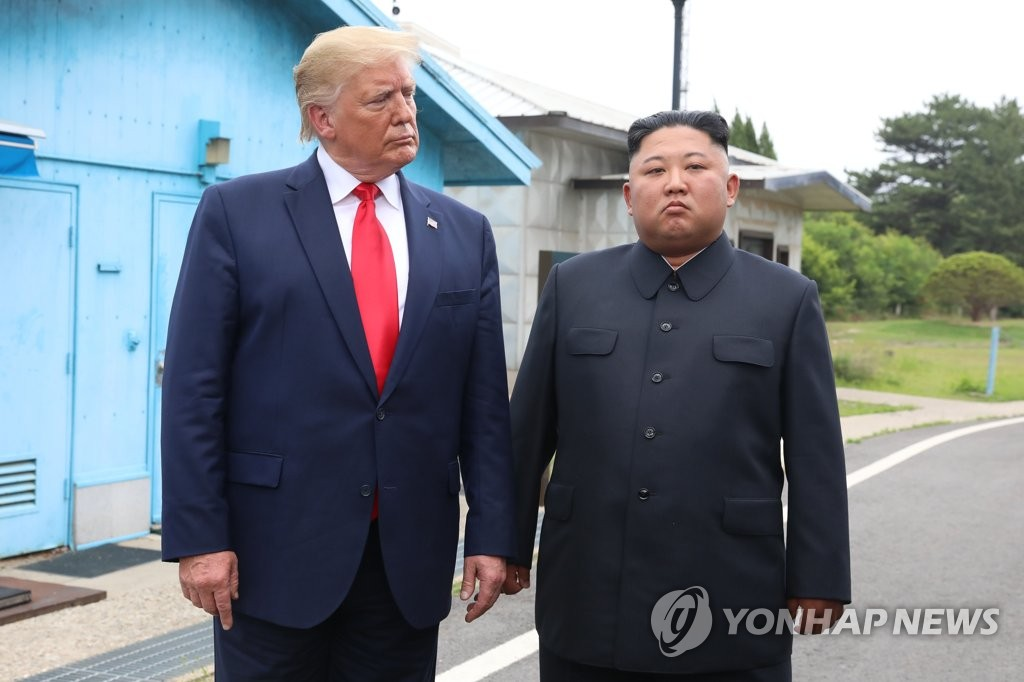 In this file photo, taken June 30, 2019, U.S. President Donald Trump (L) stands with North Korean leader Kim Jong-un before they hold talks at the Freedom House on the southern side of the truce village of Panmunjom in the Demilitarized Zone, which separates the two Koreas. (Yonhap)