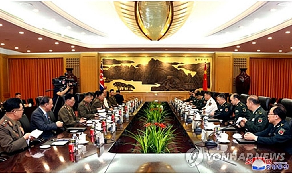 North Korean military officials, headed by Kim Su-gil, director of the General Political Bureau of the North's Korean People's Army, hold talks with their Chinese counterparts in Beijing in this photo released by the Korean Central News Agency (KCNA) on Aug. 18, 2019. (For Use Only in the Republic of Korea. No Redistribution) (Yonhap)