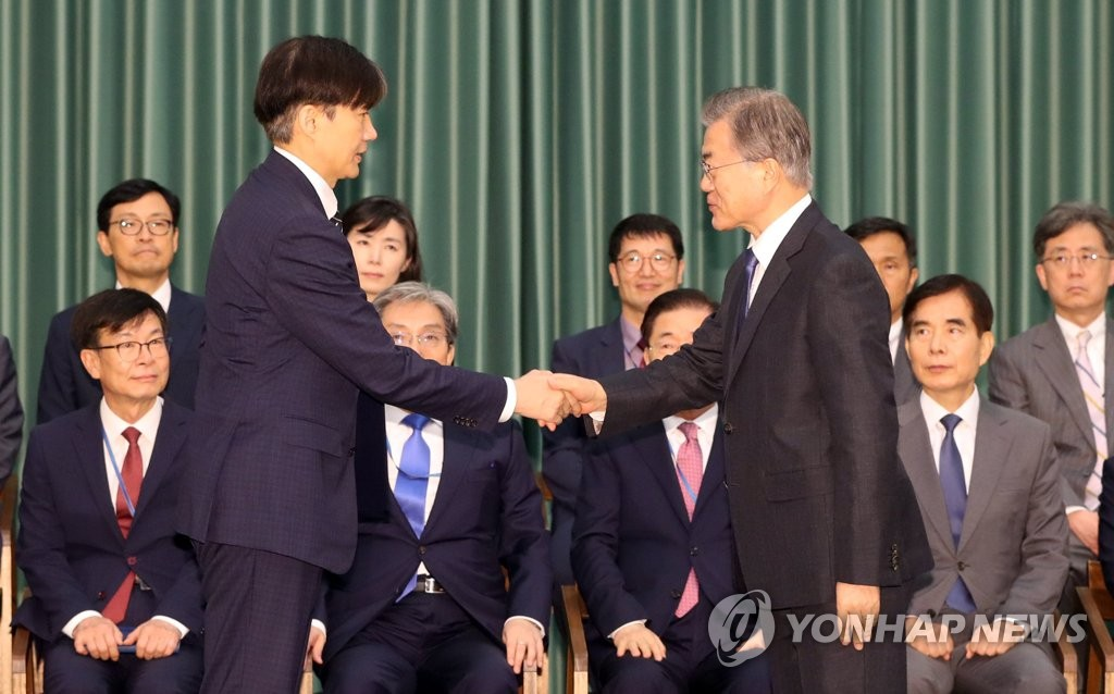 President Moon Jae-in (R) shakes hands with Justice Minister Cho Kuk at Cheong Wa Dae in Seoul after appointing him to the post on Sept. 9, 2019. (Yonhap)
