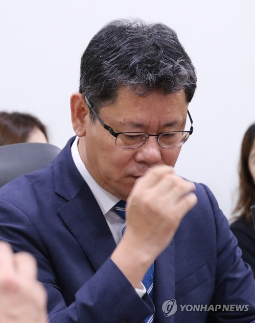 Unification minister at policy meeting